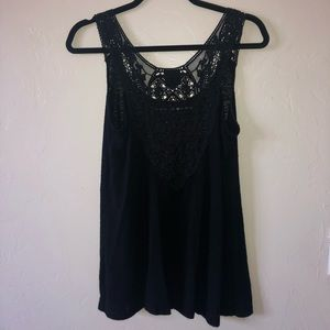 Black tank top with open back design